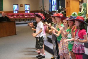Father Tony Childs enjoys the songs at St. Michael's Vacation Bible School 2013.